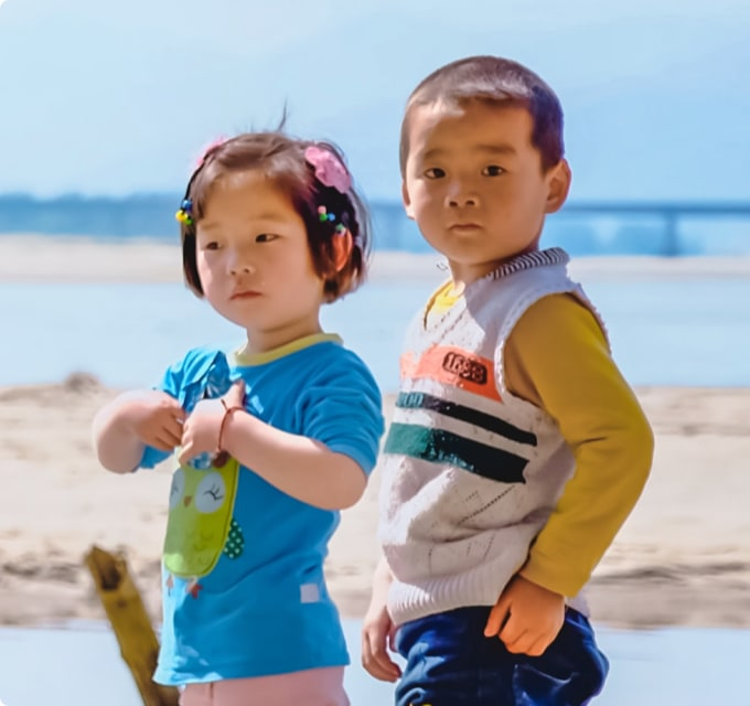 Two young children at the seaside