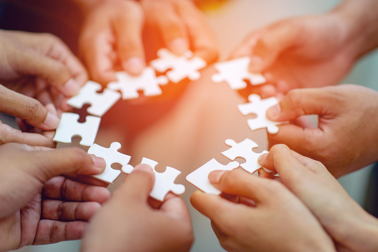 Hand holding jigsaw pieces