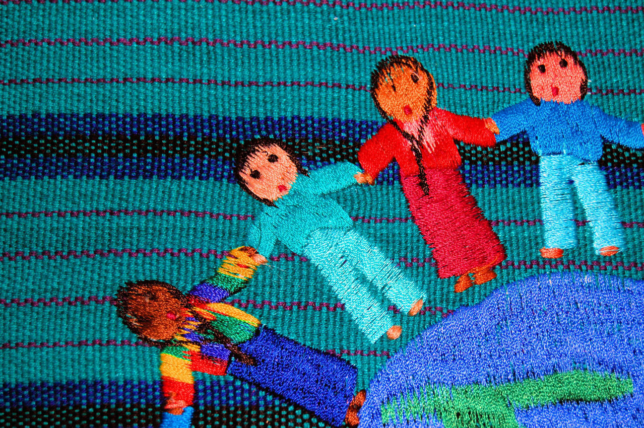 Children of the world sewn on to some fabric
