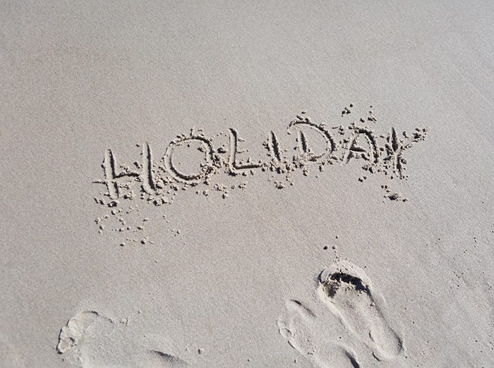 Holiday etched in to sand